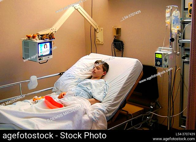 10 year old male child in a hospital bed