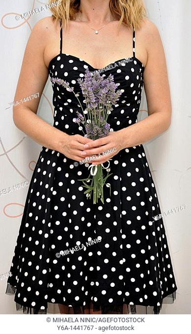 Woman holding bunch of lavender