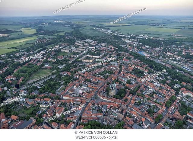 Germany, aerial view of Quedlinburg with St. Nicholas' Church in the evening