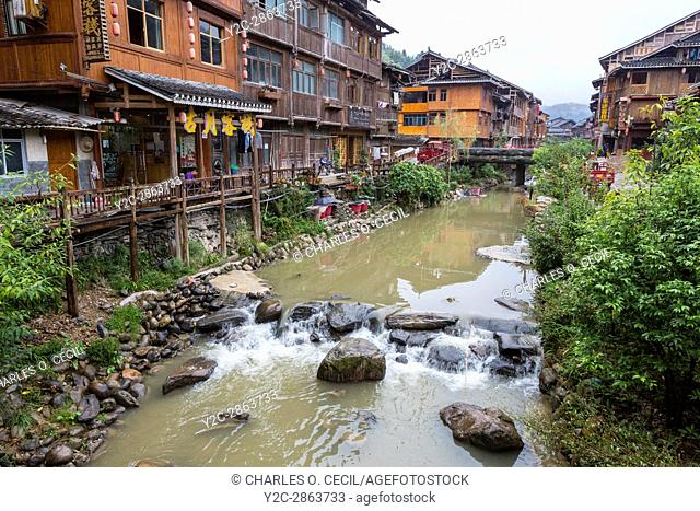 Zhaoxing, Guizhou, China, a Dong Minority Village. Houses and Shops Line the River Running through the Village