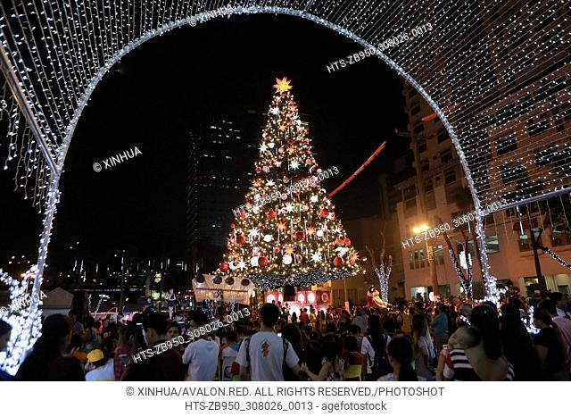 QUEZON CITY, November 25, 2017 (Xinhua) -- People gather around a giant Christmas tree as they stroll at a night market in Quezon City, the Philippines