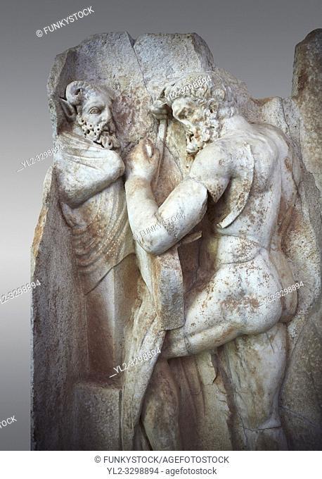 Close up of a Roman Sebasteion relief sculpture of Herakles is preparing to wrestle the Libyan giant Antaios. Aphrodisias Museum, Aphrodisias, Turkey