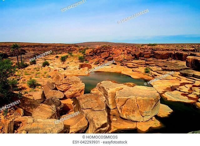 Panorama of rocky pond on Adrar plateau, Mauritania