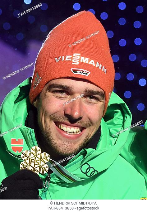 German world champion Johannes Rydzek with his gold medal at the FIS Nordic World Ski Championships 2017 in Lahti, Finland, 24 February 2017