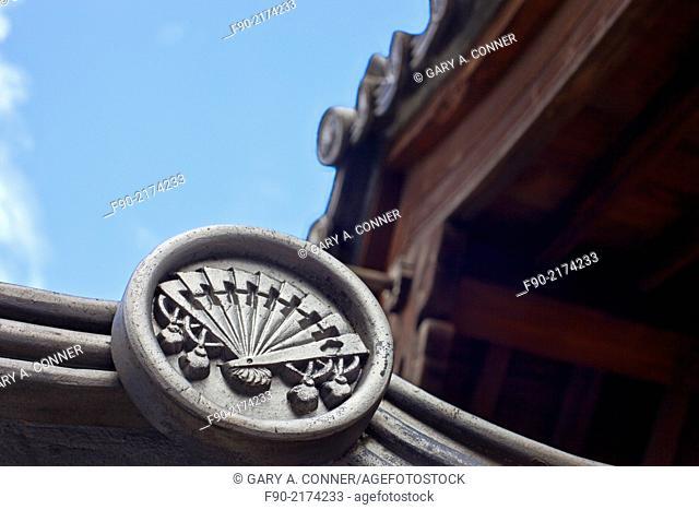 Design motif on ceramic roof tile, kawara, at Hotoh-Ji Temple in Gotanda, Tokyo, Japan