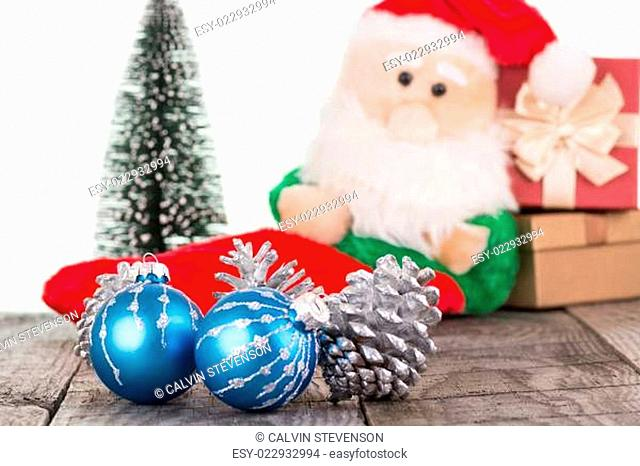 Christmas baubles and Santa Claus toy close-up