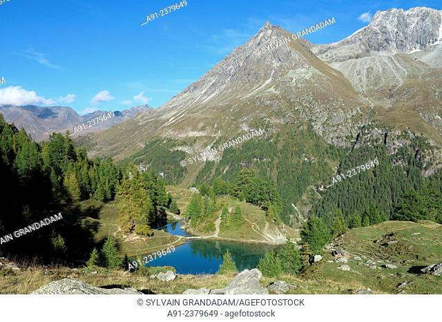 Switzerland, Valais, Val d'Herens, village of Evolene, La Gouille Blue Lake
