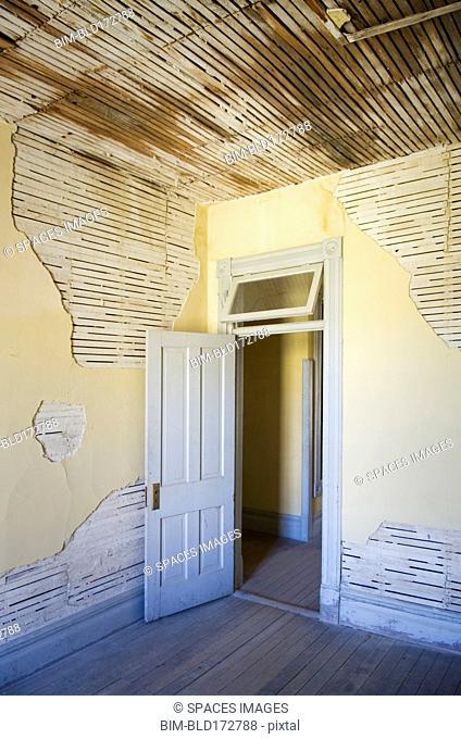 Open door of dilapidated room