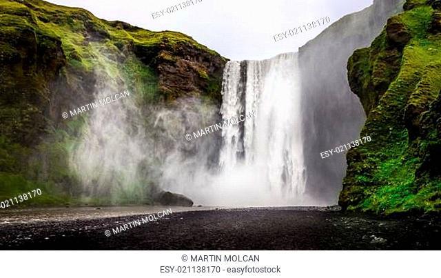 Landscape view of wild Skogafoss waterfall in Iceland