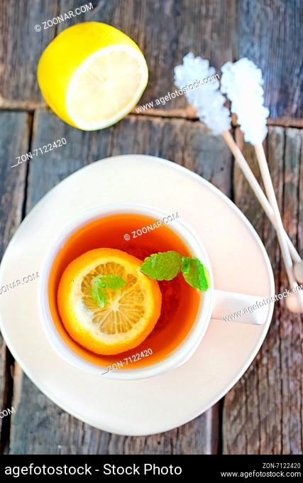 fresh tea with mint and lemon in cup