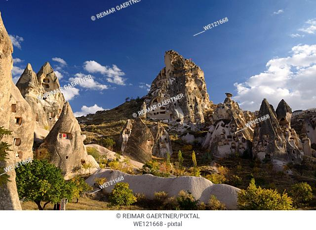 Ancient Uchisar Castle houses and tunnels at sunset carved out of volcanic tuff Cappadocia Turkey