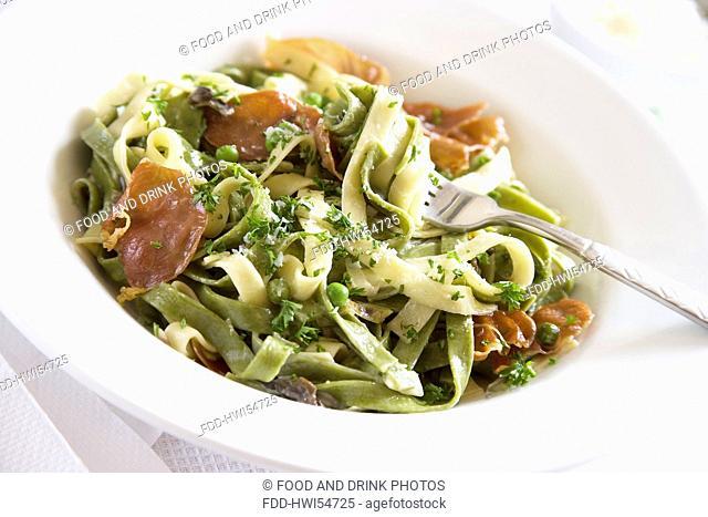 Cooked Tagliatelle pasta with cream, Parma Ham, garlic mushrooms, peas and Parmesan