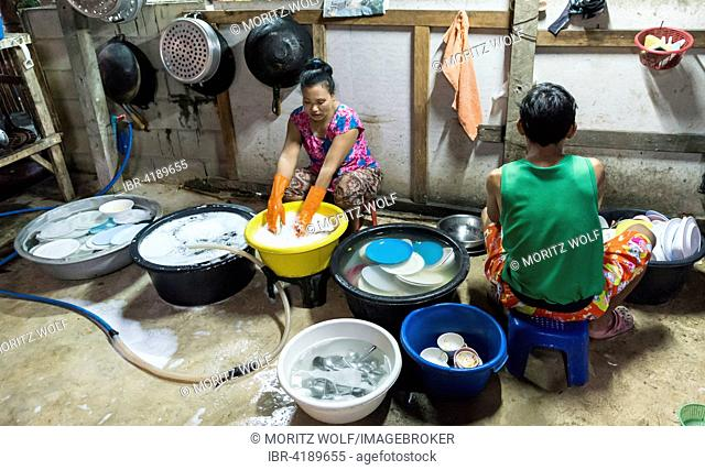 Thai woman washing dishes and pots, traditional restaurant, Kanchanaburi Province, Central Thailand, Thailand