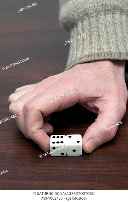 hand holding a couple of dice