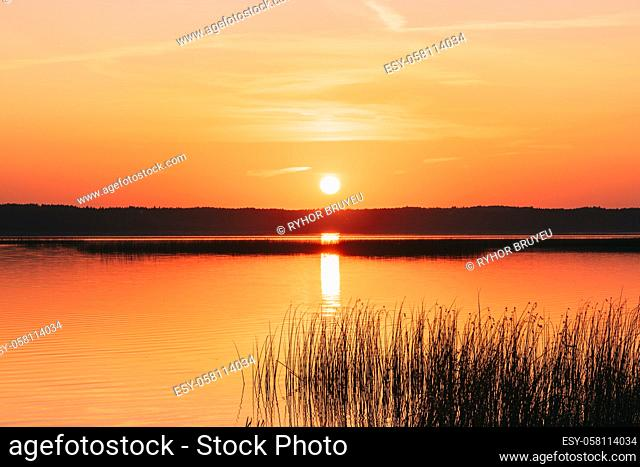 Sundown Above Lake River Horizon At Sunset. Natural Sky In Warm Colors Water. Sun Waters