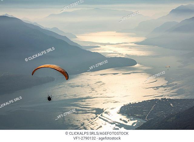 Paragliding over Lake Como and the surroundings mountains. Alto Lario, Como, Lombardy, Italy, Europe