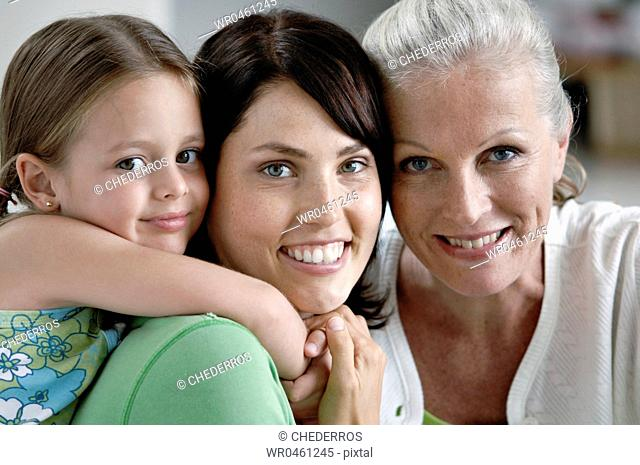 Portrait of a girl smiling with her mother and grandmother