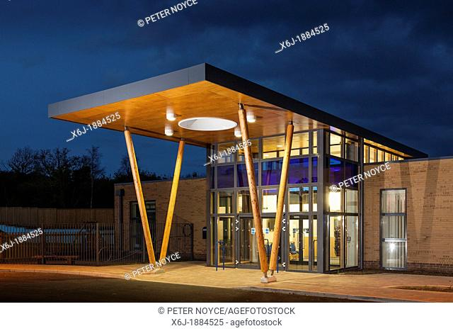 the modern architecture canopy forming the main entrance to Mountjoy School, Beaminister at dusk