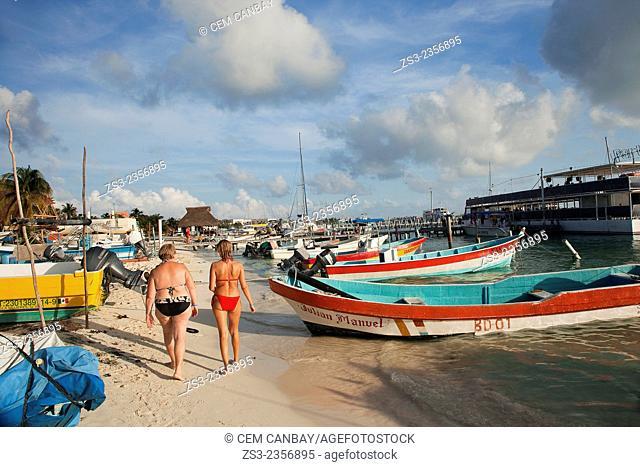 Women in bikini walking on the beach, Isla Mujeres, Cancun, Quintana Roo, Yucatan Province, Mexico, Central America