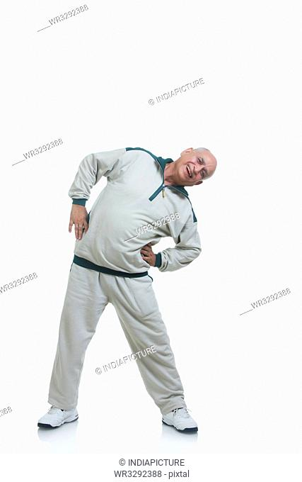 Portrait of old man exercising
