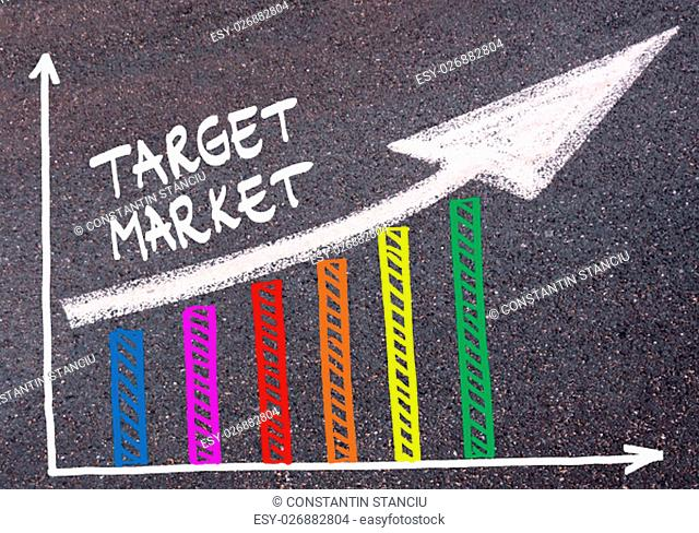 Colorful graph drawn over tarmac and words TARGET MARKET with directional arrow, business design concept