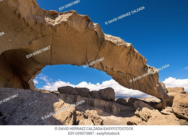 Natural volcanic rock arch formation in desertic landscape in Tenerife, Canary islands, Spain