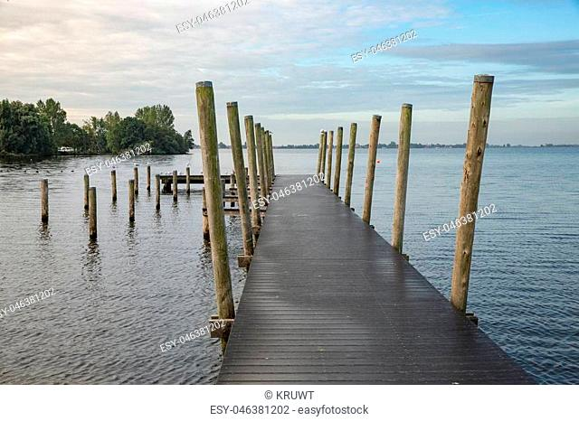Wooden landing-stage at Dutch lake in the early morning
