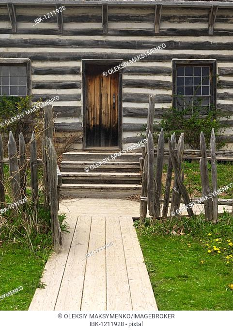 Path leading to an old wooden country house door, Ontario Canada