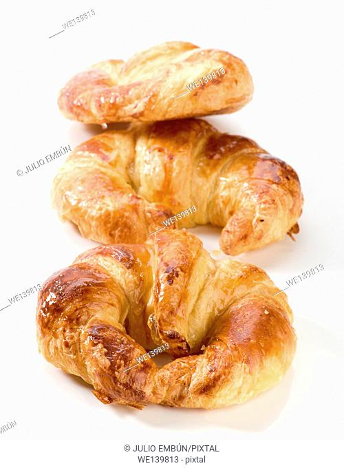 fresh croissants with honey coverage