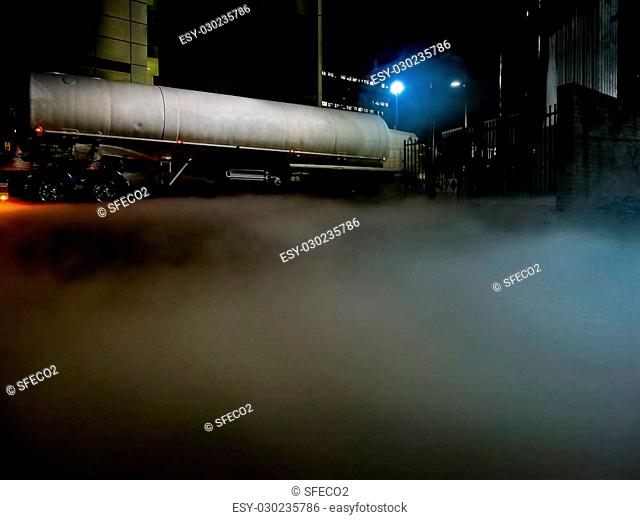 Tanker on site to refill liquid nitrogen, spreading out dense plumes of cold white fumes during the process