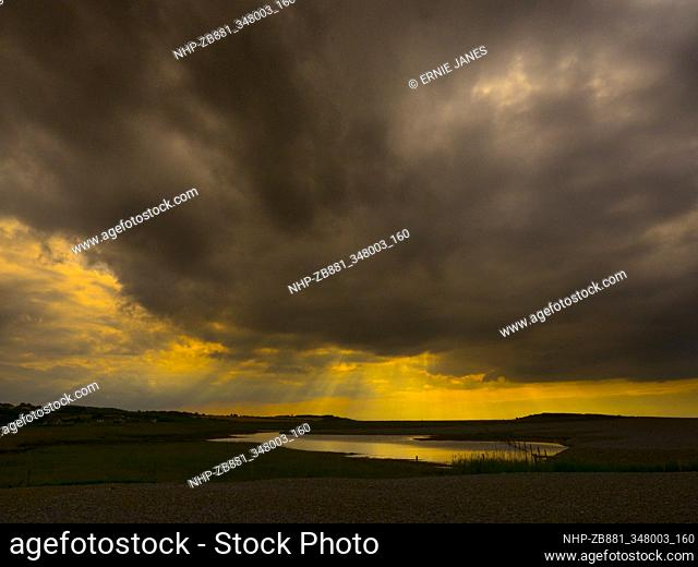 Stormy sky beach and marshes at Salthouse Norfolk