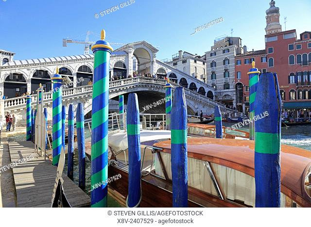 Gondola poles by the Rialto Bridge on the Grand Canal in Venice, Italy