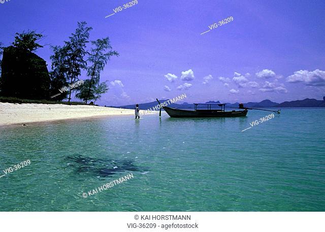 A boat at the Ao Nang Beach on the little Thai island Krabi. - KRABI , THAILAND, 13/04/2002