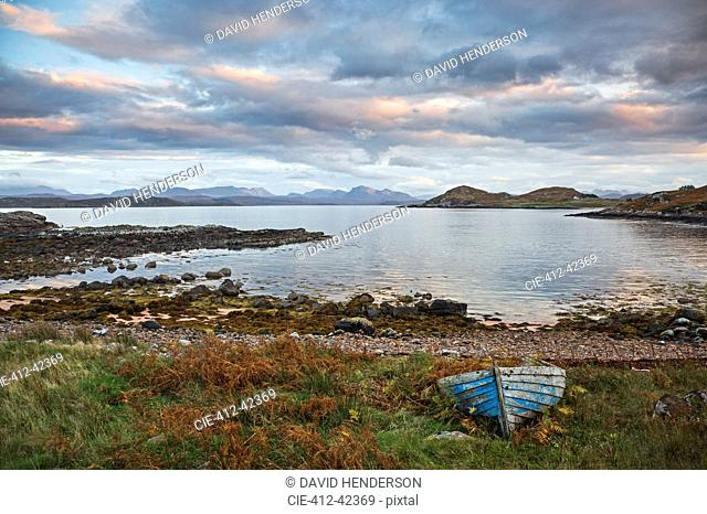 Abandoned boat at remote tranquil lake, Cove, Loch Ewe, Wester Ross, Scotland