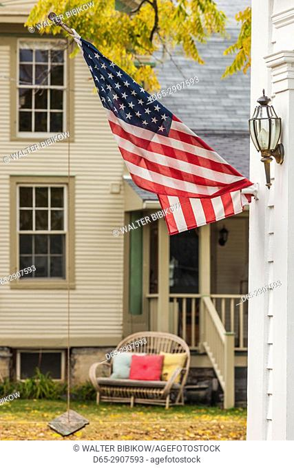 USA, New York, Adirondack Mountains, Essex, building detail with US flag