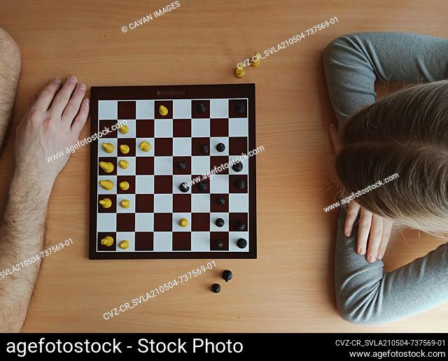 two players are thinking while playing chess top view