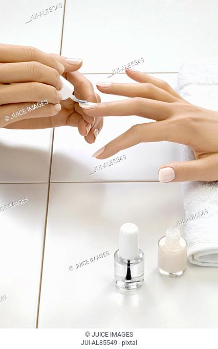 Close up of woman's hand receiving manicure treatment