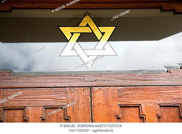 Gold Star of David on window of synagogue