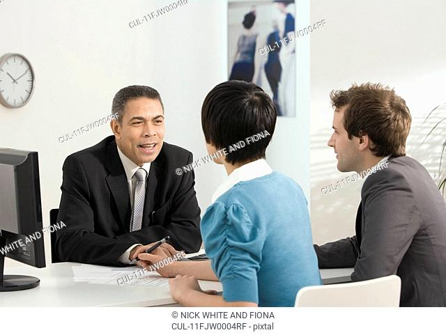 A couple meet with a business manager