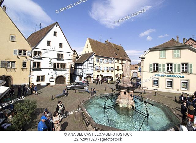 Eguisheim village, traditional colorful houses on May 14, 2016 in Alsace, France. The fountain at the main square