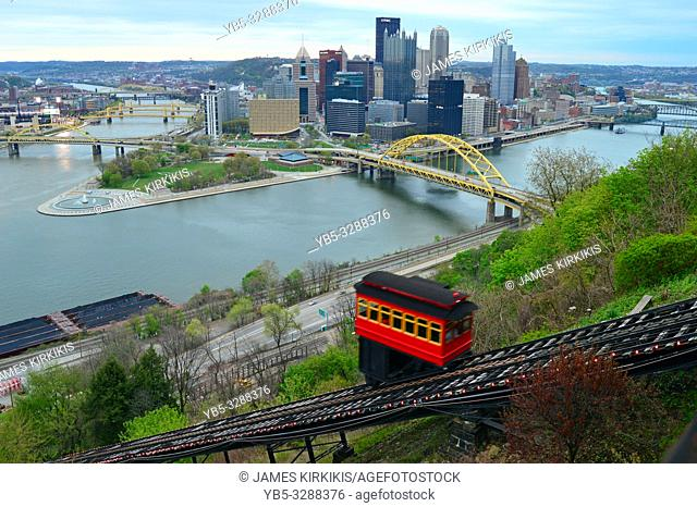The Duquesne funicular climbs a cliff, offering splendid views of the Pittsburgh, Pennsylvania skyline