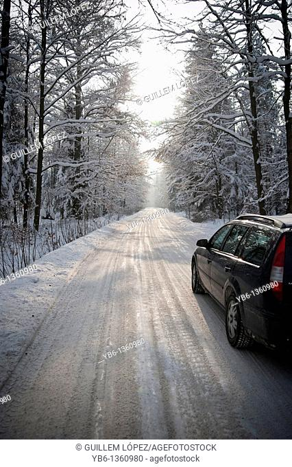 Car circulating in a frozen road, Jelenia Gora, Poland
