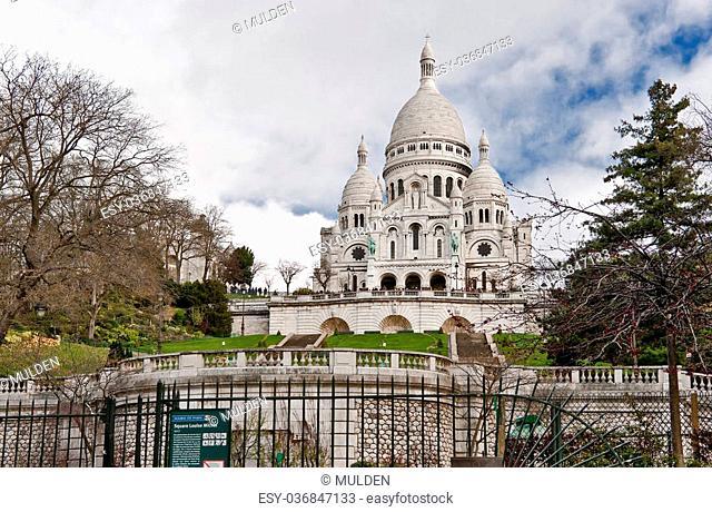 Basilica of the Sacred Heart of Paris (Basilique du Sacré-Cœur) in cloudy spring day