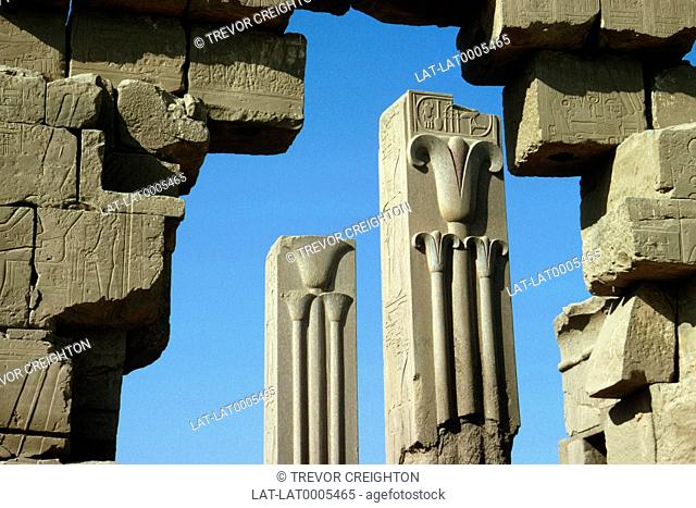 Temple of Karnack. Stone blocks. Carved detail on pillars depicting lotus and papyrus motifs. Blue sky