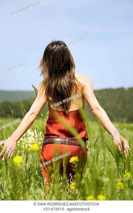 Woman waliking in the countryside