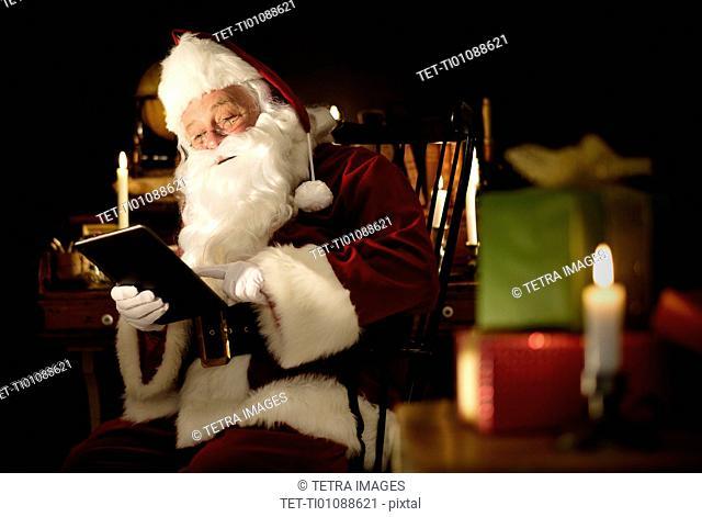 Santa Claus using digital tablet