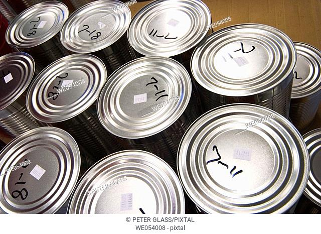Close-up of metal cans as seen from the top
