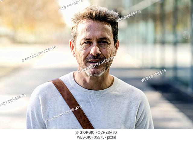 Mature man commuiting in the city