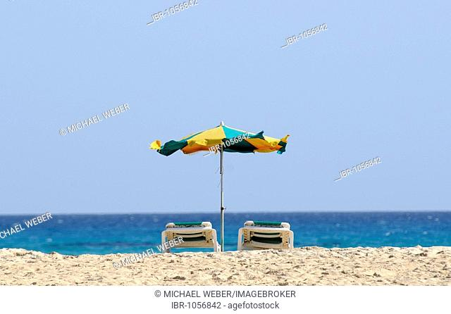 Sun umbrella and beach lounges, Playa Bajo Negro beach, Fuerteventura, Canary Islands, Spain, Europe