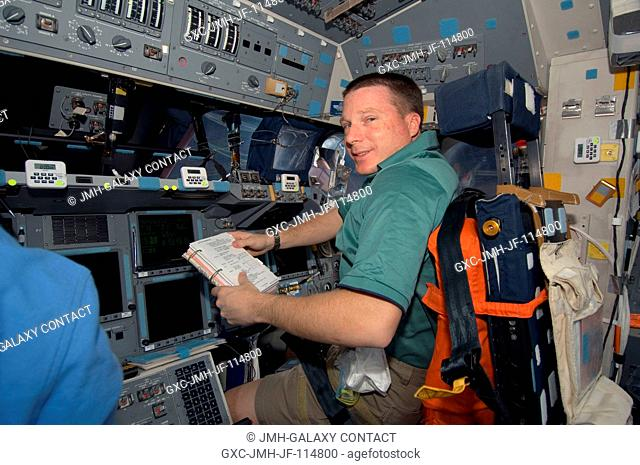 NASA astronaut Terry Virts, STS-130 pilot, occupies the pilot's station on the flight deck of space shuttle Endeavour during flight day one activities
